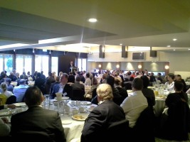 Billson speaking at Adviser brekkie